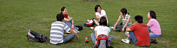 International students talk while sitting in a circle